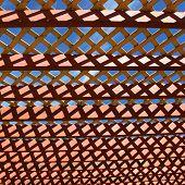 Close up shot of pergola roof against blue sky