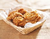 stock photo of southern fried chicken  - fried chicken pieces in a basket - JPG