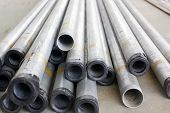 stock photo of catheter  - Stock of steel or iron pipes on construction - JPG
