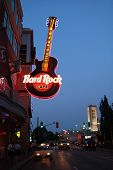 NIAGARA FALLS, CANADA- AUGUST 19, 2013:  Neon sign of Hard Rock cafe, one of the restaurant and stores on Clifton's street at Niagara falls on 19 August in Niagara falls, Ontario, Canada