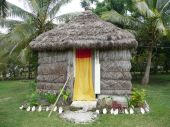 A Grass Sleeping Hut On Noumean Island Of Lifou.