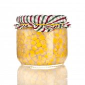 Canned corn  in a glass jar  pot isolated on white background
