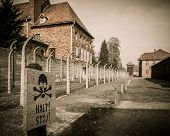 stock photo of horrific  - Electric fence in former Nazi concentration camp Auschwitz I - JPG