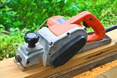 Close Up Construction Worker's Hand And Power Tool While Planing