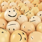 foto of angry smiley  - One smiley ball on top of heap of angry balls with different emotions - JPG