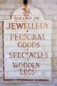 Old fashioned sign for a pawnbroker