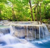 Waterfall landscape background. Beautiful nature outdoor photography. Thailand green rain forest jun