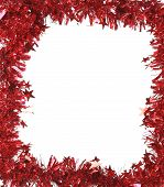Christmas red tinsel as frame.