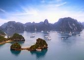 Halong Bay Vietnam panoramic view background. Mountains, islands and tourist boats on beautiful sea