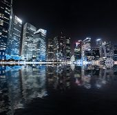 Singapore skyline night panorama. Modern urban city view of business district in downtown near Marin