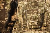 Stone faces on the towers of ancient Bayon Temple in Angkor Thom, Cambodia