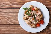 stock photo of marsala  - stew chicken with mushrooms on a white plate with vegetables top view close - JPG