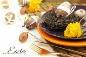 Easter table setting with eggs and cutlery