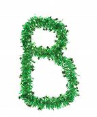 Green tinsel with stars in form of letter B.