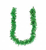 Green tinsel with stars in form of letter U.