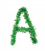 Green tinsel with stars in form of letter A.