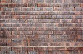 Red Chipped old brick wall with two rows protruding