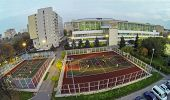 MOSCOW - OCT 11: View from unmanned quadrocopter to people plays on basketball playground in front t