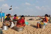 CHENNAI, INDIA - FEBRUARY 10, 2013: Local Indian women on Marina beach in Chennai. Marina beach is t