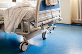 Empty Hospital Bed On Hospital Ward