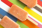 Strawberry, Orange, Pineapple, Mango Fruit Popsicles On Colorful