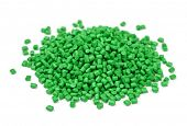 Pile of green polymer granules isolated on white