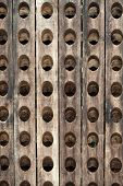 Close up of the old wooden bottle rack