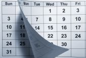stock photo of weekdays  - close up of a page of a calendar - JPG