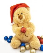 Toy Bear In A Christmas Cap And With Christmas-tree Decorations