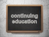 Education concept: Continuing Education on chalkboard background