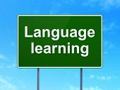 Education concept: Language Learning on road sign background