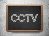 Privacy concept: CCTV on chalkboard background