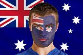 Composite image of serious young australia fan with facepaint against australian flag