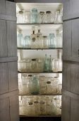Shelves of Old Canning Jars