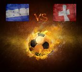 Hot soccer ball in fires flame, game Honduras and Switzerland