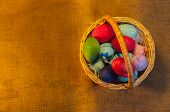 Easter Eggs in Basket on sackcloth background