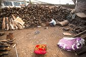 KATHMANDU, NEPAL - DEC 19, 2013: Unidentified man sorts wood for cremation rites in Bhasmeshvar Ghat