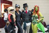 LONDON, UK - OCTOBER 26: Cosplayers dressed as a  Harley Quinn, Catwoman and Poison Ivy from Batman