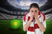 Nervous football fan looking ahead against vast football stadium with fans in white