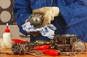 stock photo of carburetor  - Master repairing the old car engine fuel pump