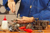 stock photo of carburetor  - Repair of old parts automobile engine in the workshop