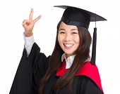 Asian graduate girl with victory sign