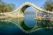 foto of jade blue  - The jade belt bridge of Summer Palace under the morning sunshine - JPG