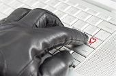 Online Exploiting Heartbleed Bug Concept With Hand Wearing Black Glove