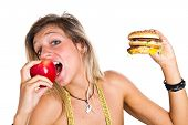 beautiful woman with red apple and hamburger