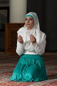 pic of tasbih  - Young Muslim Woman Praying In Mosque  - JPG