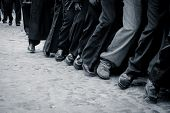 foto of street-walker  - black and white shot of male feet walking in street procession - JPG