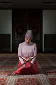 image of tasbih  - Muslim Woman Reading Holy Islamic Book Koran - JPG