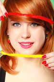 Redhaired Girl Holding Sweet  Candy
