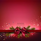 stock photo of christmas greetings  - Christmas background with red bow and fir twigs garland - JPG